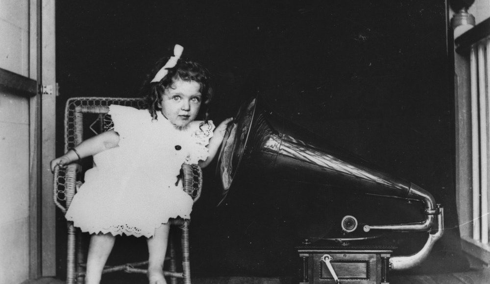 Girl listening to gramophone | AYZ writing